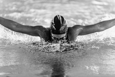 action shot: High speed action shot of a butterfly stroke swimming champion