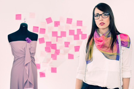 20 24: Cool young fashion designer in clothing design studio, toned image