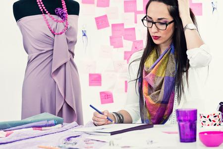 toned image: Fashion designer working in studio. Toned image
