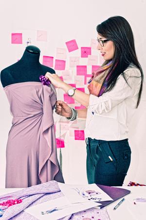 20 24: Fashion designer working on a new dress, toned image