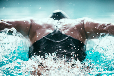 Butterfly stroke swimmer from behind