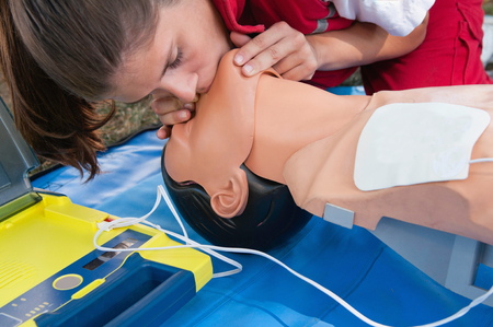 compressions: CPR - medical emergency procedure with defibrillator