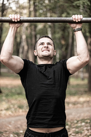 strong chin: Male athlete doing pull ups Stock Photo