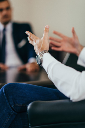selective focus: Business talk - company managers having a meeting. Toned image, selective focus Stock Photo
