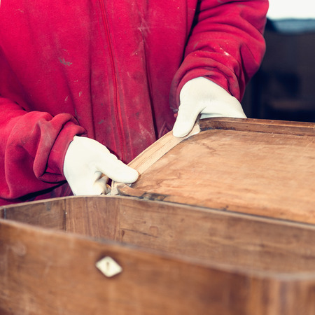 antique furniture: Antique furniture restauration - Specialized carpenter carefully restoring old furniture