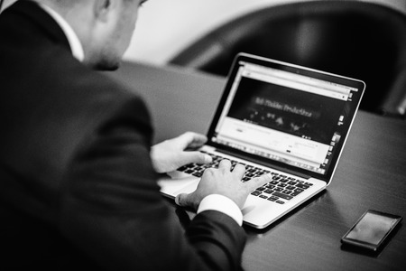 white work: Businessman at work in black and white