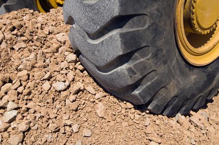 dirt pile: Construction vehicle wheel