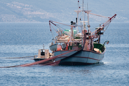 Fishing vessel with casted nets