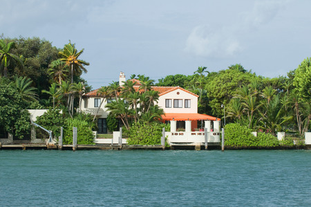 waterfront property: Waterfront house with lush vegetation. Polarizing filter.