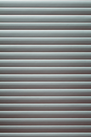 metalic texture: Tightly closed window blinds, brushed alluminium, convenient as background Stock Photo
