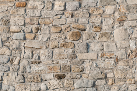deep focus: Large rough stone wall, deep focus convenient for backgrounds Stock Photo