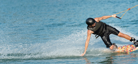 exhilaration: Wakeboarder creating a water curtain behind, XXXL format, convenient copy space Stock Photo