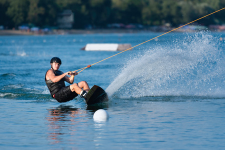 wakeboarding: Young man wakeboarding on a lake