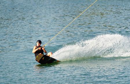 exhilaration: Sportsman enjoying on wakeboard