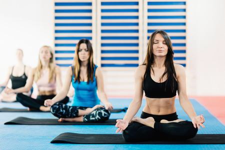 lotus position: Group of women meditating in lotus position