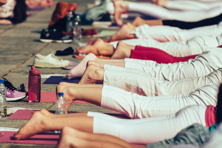 buena postura: Detail of legs on yoga event. Detail of legs nad feet.