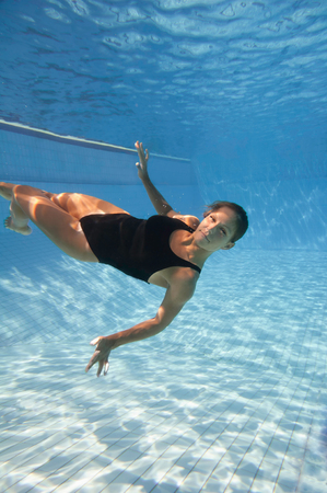 attractive female: Attractive female athlete relaxing underwater