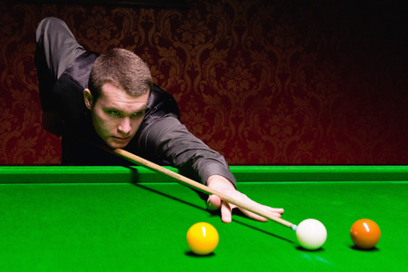 pool hall: Snooker player during game