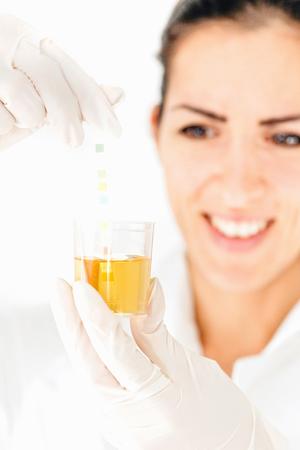 medical sample: Medical worker testing urine sample. High key, selective focus