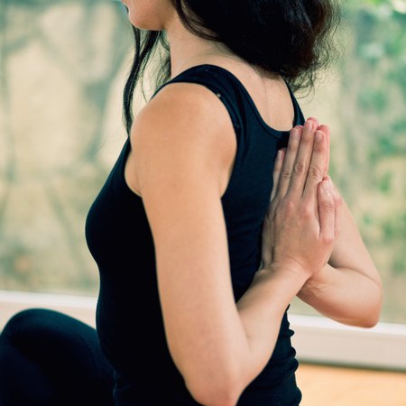 reverse: Yoga reverse prayer position. Close-up, toned image