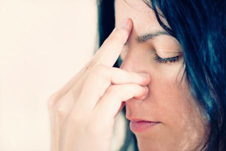 breathing exercise: Pranayama - Yogic breathing exercise. Close-up portrait, toned image