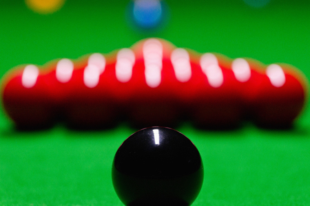 starting position: Black snooker balls in starting position. Shallow depth of field