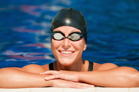pool side: Relaxed smiling swimmer at the pool side Stock Photo
