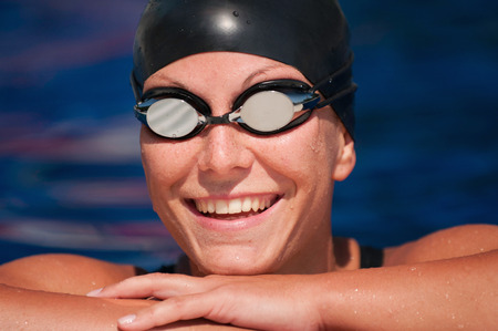 pool side: Portrait of a smiling female swimmer at the pool side