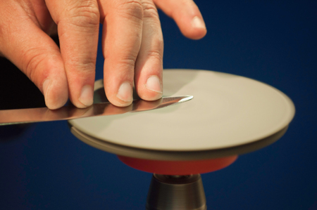 metal tips: Knife sharpening on the spinning disk, selective focus