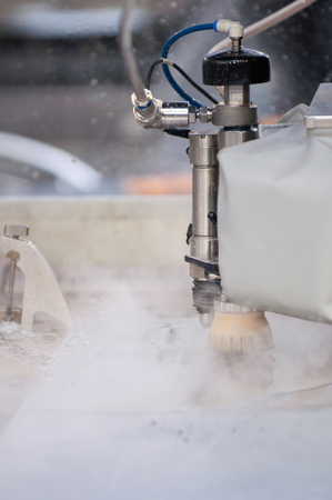 metal cutting: Automated waterjet metal cutting machine in action