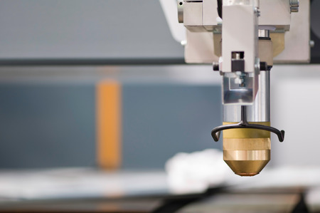 metal cutting: Plasma cutter, industrial metal cutting cnc machine. Shallow depth of field, copy space on the left Stock Photo