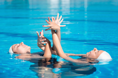 two person only: Synchronized swimmers performing Stock Photo