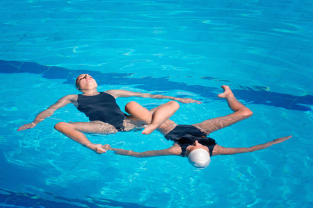only two people: Synchronized swimmers performing Stock Photo