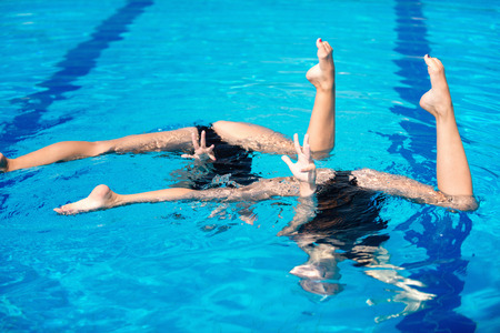 duet: Synchronized swimming duet routine Stock Photo