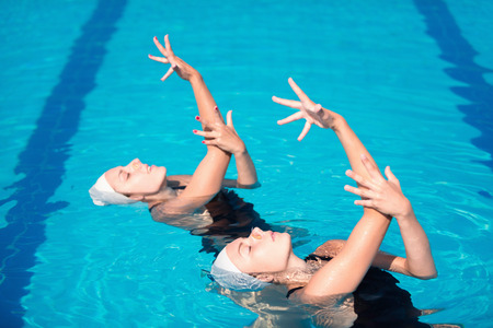 Synchronized swimming duet performing their routine