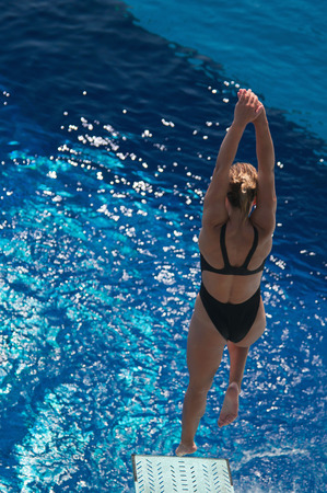 springboard: Female diver bouncing on the springboard