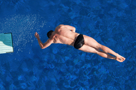 twisting: Twisting springboard dive from above