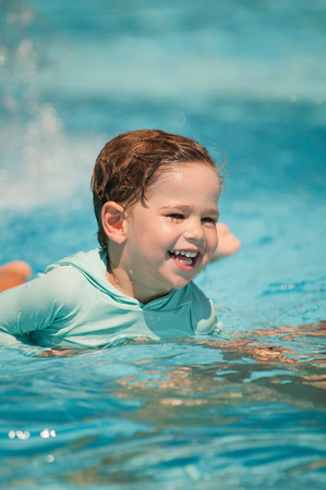 two year old: Happy two year old kid in swimming class for small children