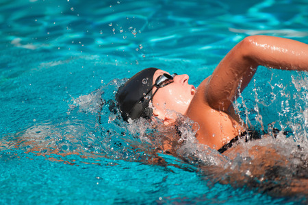 splash back: Front crawl swimmer from behind Stock Photo