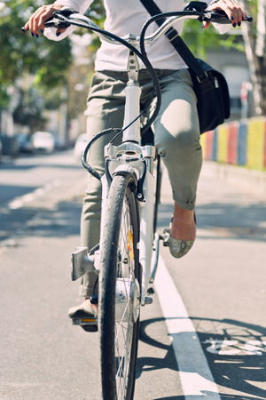 car front view: Commuter using electric bicycle to go to work Stock Photo