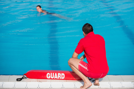 Lifeguard on duty by the pool Stock Photo