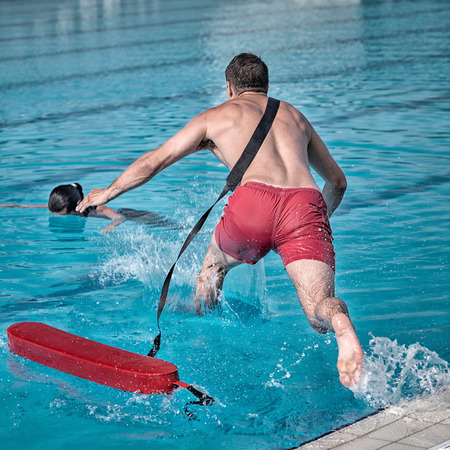 rushes: Lifeguard rushes into the pool