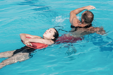 rescuing: Lifeguard in training, rescuing victim from water Stock Photo
