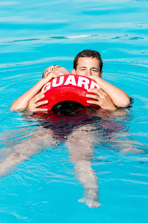 the unconscious: Lifeguard swimming with unconscious victim