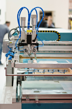 silk screen: Silk screen printing machine in printers office Stock Photo