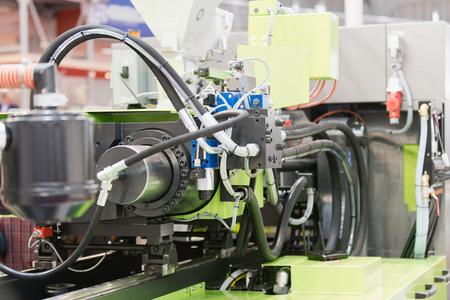 máquina de moldeo por inyección de plástico industrial Foto de archivo