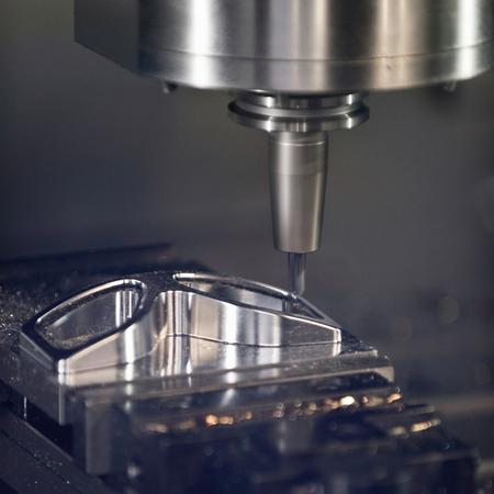 Automated metal work lathe close-up Stock Photo