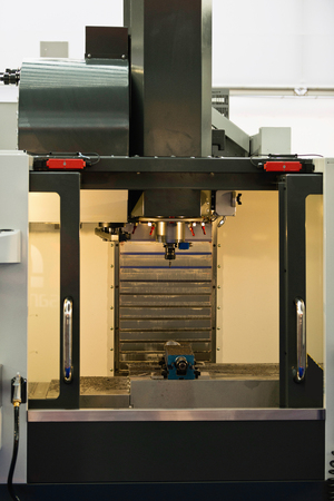 metal processing: Automated metal processing lathe used in manufacturing of metal objects