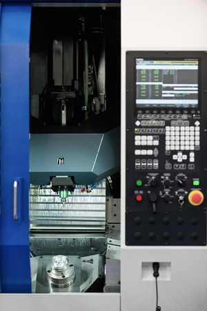machining center: Compact automated vertical spindle machining center Stock Photo