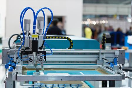 Silk screen printing machine in printing factory
